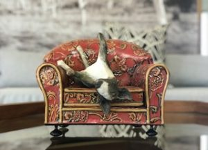 trayci tompkins, ceramic sculpture, south african ceramics, bull terrier, dog on a couch
